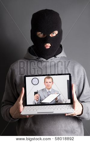 Masked Man With Laptop - Concept Picture Of Internet Crime
