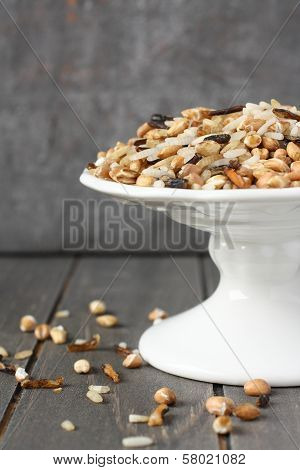 Uncooked Multigrain Rice On White Plate On Wooden Background