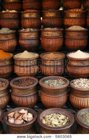 Beautifully Carved Handmade Pots Full Of Aromatic Spices On The Marketplace