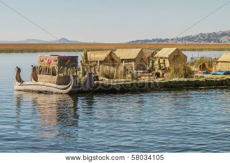 iew of floating island Uros Lake Titicaca Peru Bolivia and reed boat with its reflection.