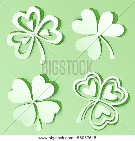Green cutout paper vector clovers