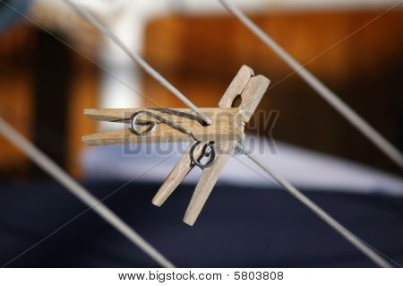 Two wooden clothespins