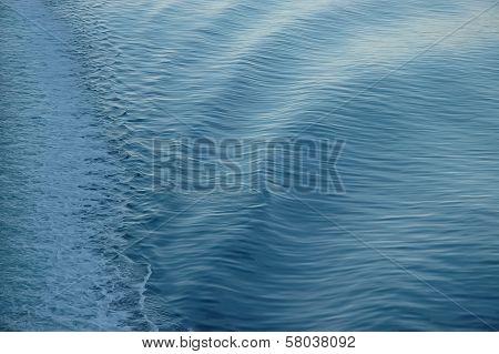 White Backwash Of A Ferry Crossing Blue Ocean