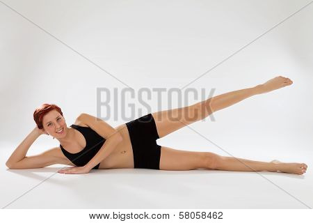 Fitness Woman Exercising With Her Legs