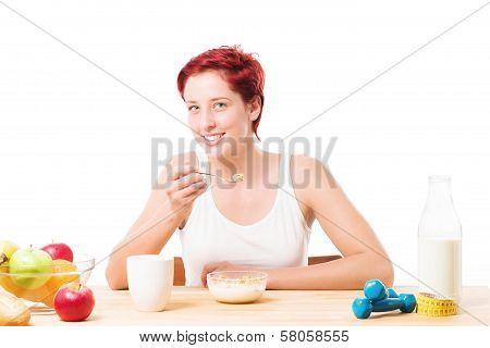 Woman Eating Cornflakes At Breakfast