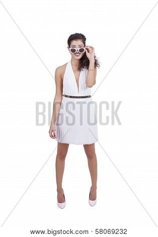Smiling young woman posing with sunglasses