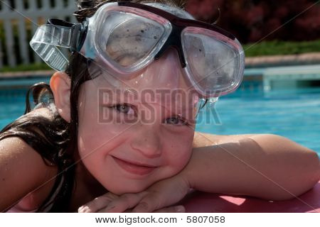 Girl Floatin In The Pool