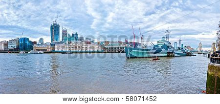 Modern London cityscape with HMS Belfast and Union Jack