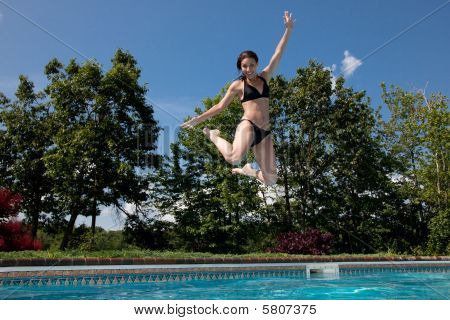 Woman Jumping Into A Pool And Celebrating