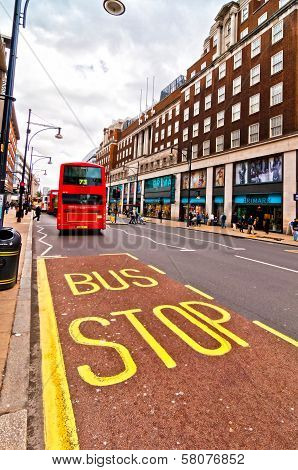 British icon double decker bus along Oxford Street in London, UK