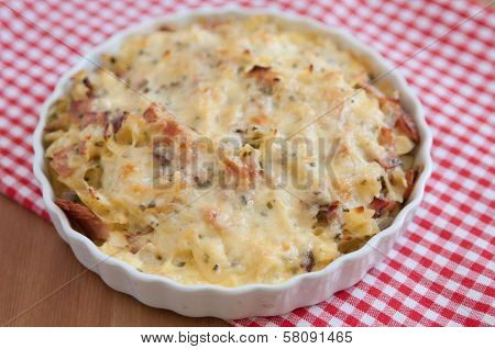 Creamy baked pasta with bacon and cheese