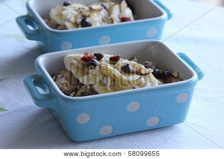 Bread pudding topped with banana and almond slices