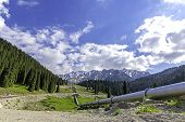 image of shan  - Pipeline on road Big Almaty Lake Tien Shan Mountains in Almaty KazakhstanAsia - JPG