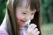 pic of playgroup  - Portrait of beautiful young girl with flowers in the park - JPG