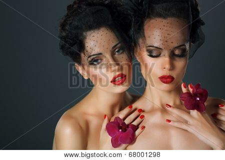 Craving. Aspiration. Two Seductive Fervent Women With Flowers