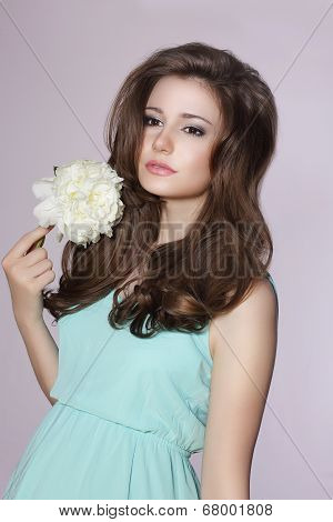 Sincere Gentle Meek Woman With Peony Flower