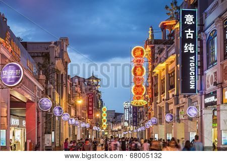 GUANGZHOU, CHINA - MAY 25, 2014: Pedestrians pass through Shangxiajiu Pedestrian Street. The street is the main shopping district of the city and a major tourist attraction.