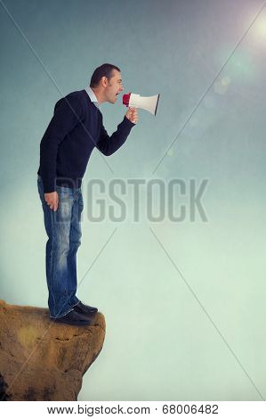 Man With Megaphone Shouting From Cliff Edge