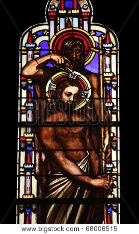 PARIS, FRANCE - NOV 11, 2012: Baptism of the Lord, stained glass from Church of St-Germain-l'Auxerr ois founded in the 7th century, was rebuilt many times over several centuries.