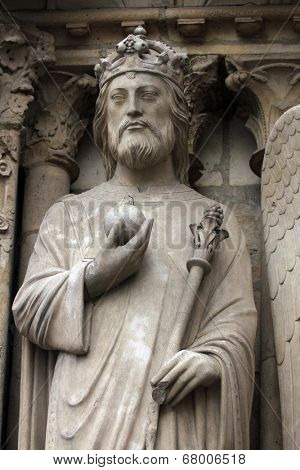 PARIS,FRANCE - NOV 05, 2012: Emperor Constantine, architectural details of Notre Dame cathedral. The Portal of the Virgin, dedicated to the patroness of the cathedral, was sculpted in the 1210s-1220s.