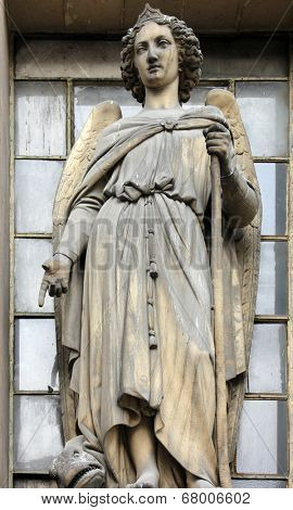 PARIS, FRANCE - NOV 09, 2012: Archangel Raphael, architectural details of Eglise de la Madeleine. Madeleine Church was designed in its present form as a temple to the glory of Napoleon's army.