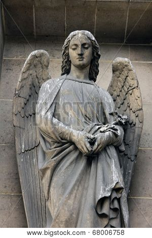 PARIS, FRANCE - NOV 09, 2012: Archangel Gabriel, architectural details of Eglise de la Madeleine. Madeleine Church was designed in its present form as a temple to the glory of Napoleon's army.