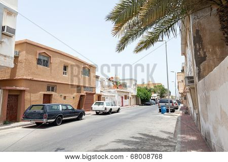 Ras Tanura, Saudi Arabia - May 10, 2014: Street View With Parked Cars, Saudi Arabia