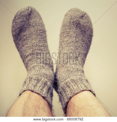 Closeup Photo Of Male Feet With Gray Woolen Socks