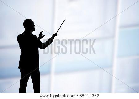 Man conducting musicians while playing a song