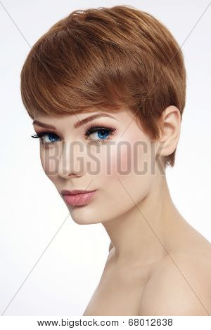 Young beautiful woman with stylish short haircut and fresh make-up