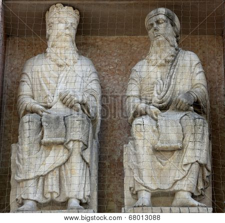 PARMA, ITALY - MAY 01, 2014: Saints, marble statue on the baptistery from Benedetto Antelami. Baptistery in Parma is considered to be among the most important Medieval monuments in Europe.