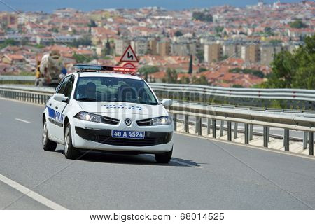 MARMARIS, TURKEY - MAY 1, 2014: Police car on the highway. Policemen check the road  before the start of 5th stage of 50th Presidential Cycling Tour of Turkey