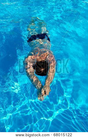 Man Swims Breaststroke Under Water In The Pool