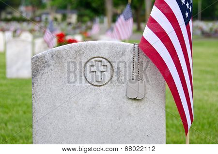 dog tags on tombstone