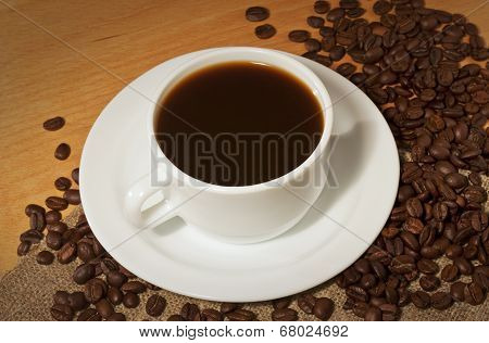A Cup Of Hot Coffee With A Lot Of Coffee Beans