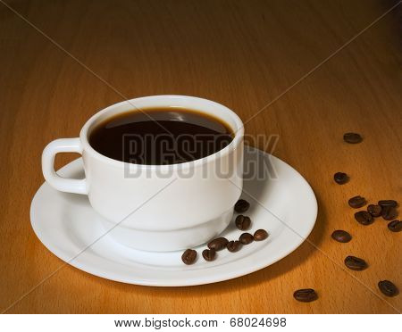 White Cup With Hot Coffee On A Saucer