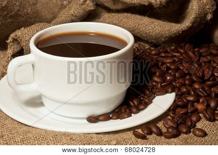 White Cup Of Coffee With A Burlap Sack