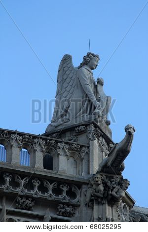 PARIS, FRANCE - NOV 06, 2012: Angel, St-Jacques Tower is 52-meters (171 ft) Flamboyant Gothic tower is all that remains of the former 16th-century Church of Saint-Jacques-de-la-Boucherie