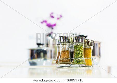 Powder spices in glass bottle jar