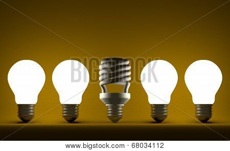 Dead Spiral Light Bulb In Row Of Glowing Tungsten Ones On Yellow