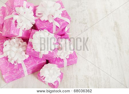 Presents Gift Boxes Stack, Birthday In Pink Color For Female Or Woman, Over White Background