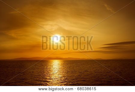 Sunset On Sea. Bright Sun On Sky. Orange Beach Landscape