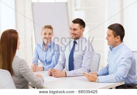 business, interview, employment and office concept - business team with tablet pc computer interviewing worker in office