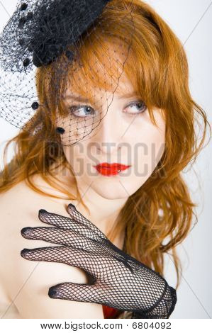 portrait of retro woman with vintage veil and red lips