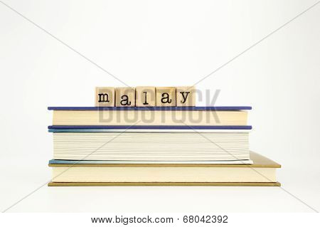 Malay Language Word On Wood Stamps And Books
