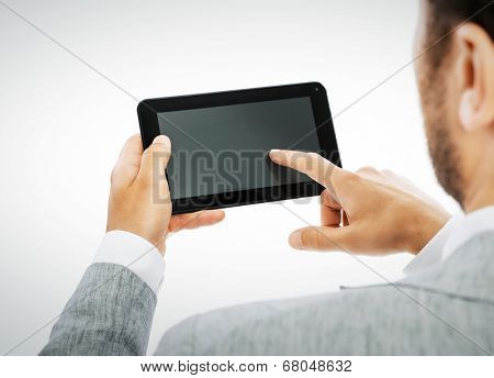 Male hands holding a tablet PC -including clipping path