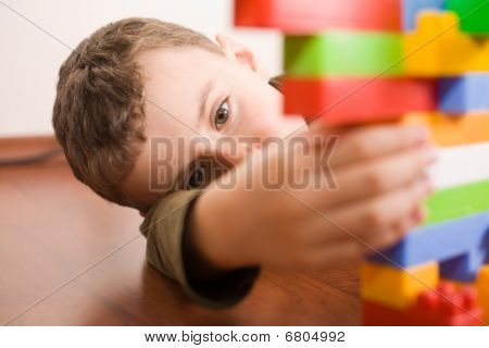 Cute Kid Playing With Cubes
