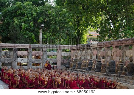 Bodhigaya - India, May 11, 2014: Tibetan Buddhist Monks And Neophytes Are Lining Up For Prepare The