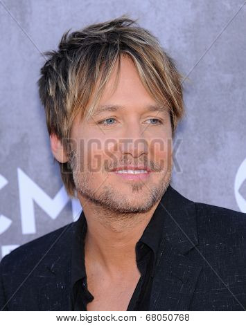 LOS ANGELES - APR 06:  Keith Urban arrives to the 49th Annual Academy of Country Music Awards   on April 06, 2014 in Las Vegas, NV.