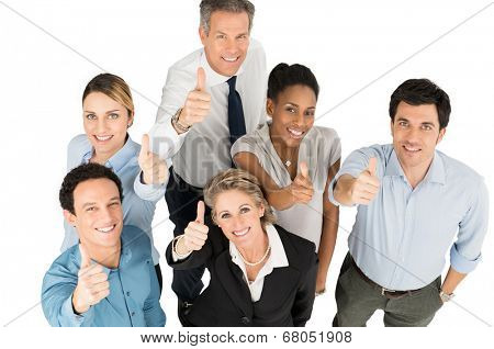 Group Of Happy Multi Ethnic Businesspeople Showing Thumb Up